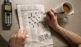 """In this photo taken April 3, 2015, Eleanor Blum, 88, solves crossword puzzles, as she lets her phone go unanswered at her in the Sherman Oaks area of Los Angeles. Jeri Vargas put her elderly mother on the """"Do Not Call"""" list years ago. So why is the 88-year-old woman with Alzheimer's disease still getting several recorded phone calls a day pitching her everything from vacation cruises to medical alert devices and fire extinguishers? (AP Photo/Damian Dovarganes)"""