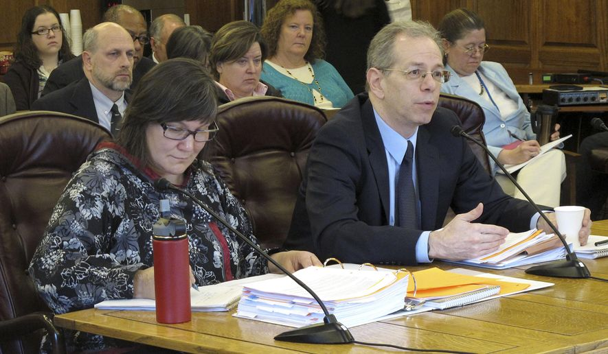 Jon Sherwood, a deputy commissioner with the state health department, right, addresses the House Finance Committee next to state health commissioner Valerie Davidson on Tuesday, April 7, 2015, in Juneau, Alaska. The committee was hearing Gov. Bill Walker's bill to expand and reform Medicaid. (AP Photo/Becky Bohrer)