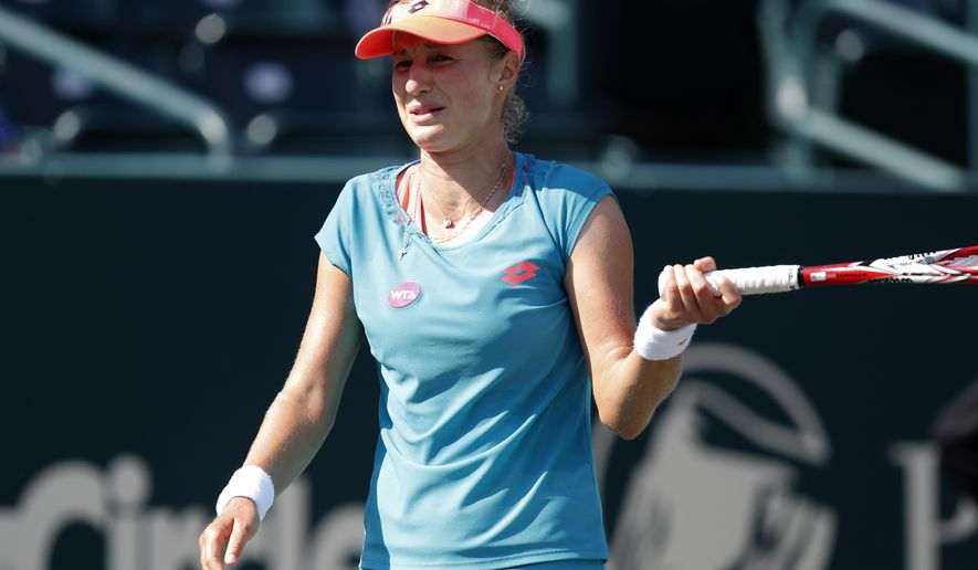 Ekaterina Makarova, of Russia, reacts to a bad shot against Shuai Zhang during a match at the Family Circle Cup tennis tournament in Charleston, S.C., Wednesday, April 8, 2015. (AP Photo/Mic Smith)