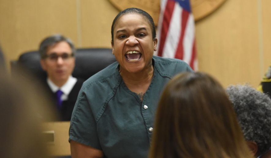 Mitchelle Blair yells out at Alex Dorsey, father of one of the children found dead in a freezer in Blair's home, at Lincoln Hall of Justice in Detroit, Wednesday, April 8, 2015. Blair, charged with slaying two of her children, was removed from court after yelling at Dorsey during a parental rights termination hearing. (AP Photo/Detroit News, Daniel Mears)