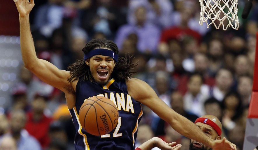 FILE - In this Nov. 5, 2014, file photo, Indiana Pacers forward Chris Copeland (22) loses control of the ball as he is guarded by Washington Wizards forward Drew Gooden (90) and forward Otto Porter Jr. (22) during the first half of an NBA basketball game in Washington. Authorities say Indiana Pacers forward Chris Copeland, his wife and another woman were stabbed outside a Manhattan nightclub after an argument. Police say the victims were hospitalized Wednesday, April 8, 2015, with minor injuries.  (AP Photo/Alex Brandon, File)