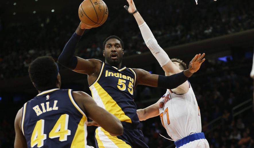 Indiana Pacers' Roy Hibbert (55) passes the ball to teammate Solomon Hill (44) as New York Knicks' Andrea Bargnani (77) defends during the second half of an NBA basketball game Wednesday, April 8, 2015, in New York. (AP Photo/Frank Franklin II)