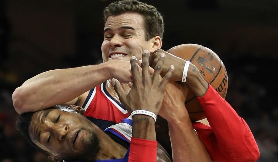 Philadelphia 76ers Robert Covington (33) gets fouled by Washington Wizards' Kris Humphries during the second quarter of an NBA basketball game, Wednesday, April 8, 2015 in Philadelphia. (AP Photo/The Philadelphia Inquirer, Steven M. Falk)  PHIX OUT; TV OUT; MAGS OUT; NEWARK OUT