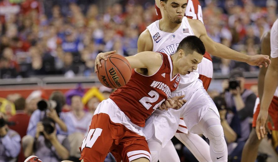 Wisconsin's Bronson Koenig drives against Duke's Tyus Jones during the second half of the NCAA Final Four college basketball tournament championship game Monday, April 6, 2015, in Indianapolis. (AP Photo/David J. Phillip)