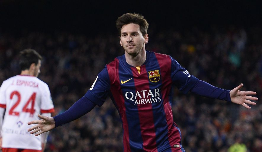 FC Barcelona's Lionel Messi, from Argentina, right, celebrates after scoring against Almeria during a Spanish La Liga soccer match at the Camp Nou stadium in Barcelona, Spain, Wednesday, April 8, 2015. (AP Photo/Manu Fernandez)