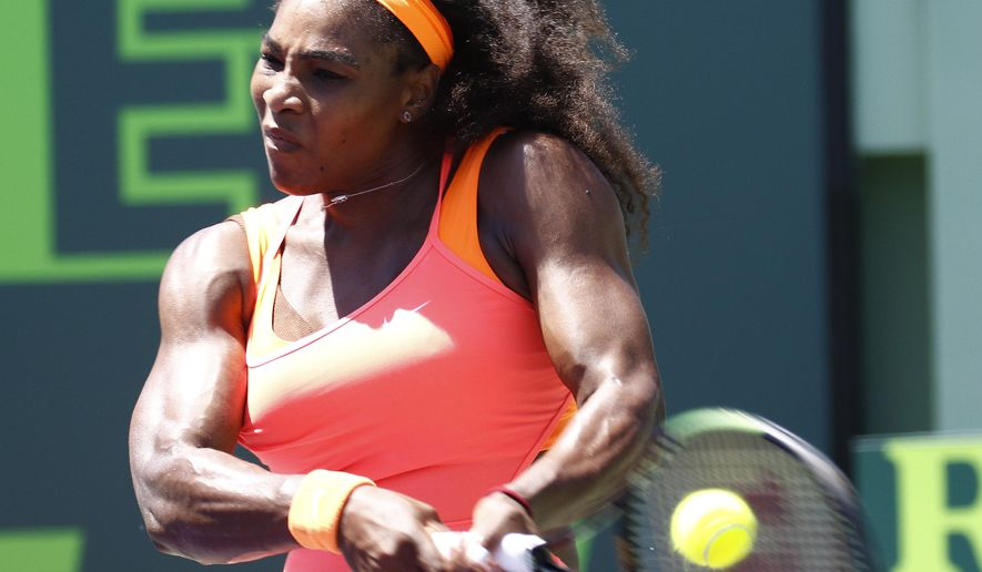 Serena Williams hits a return to Carla Suarez Navarro, of Spain, during the women's final at Miami Open tennis tournament in Key Biscayne, Fla., Saturday, April 4, 2015. Williams won 6-2, 6-0. (AP Photo/J Pat Carter)
