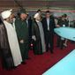 """Iran's President Hassan Rouhani (third from left), accompanied by Defense Minister Hossein Dehghan (second from left) looks at a """"Mohajer-4"""" Iran-made drone while visiting a defense industry display in Tehran. (Associated Press)"""