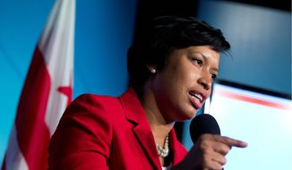 D.C. Mayor Muriel Bowser said attacking homelessness and affordable housing were two of her guiding priorities when creating her first budget for the city, which proposes sales tax and parking garage tax hikes, and cuts some funding to the University of D.C. (Associated Press) **FILE**