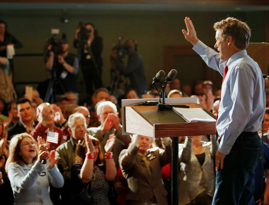 """When the founders of New Hampshire came up with motto: 'Live free or die,' they didn't leave a lot of wiggle room,"" Sen. Rand Paul, Kentucky Republican, told nearly 350 local citizens in Milford, New Hampshire as he officially opened his Republican presidential nomination campaign Wednesday. (Associated Press)"