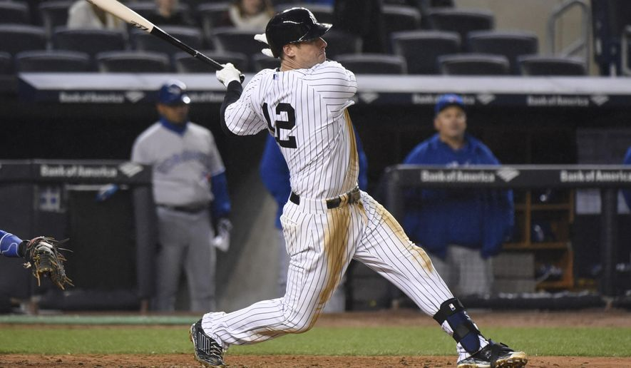 New York Yankees' Chase Headley hits an RBI-single during the eighth inning of a baseball game against the Toronto Blue Jays Wednesday, April 8, 2015, at Yankee Stadium in New York. The Yankees won 4-3. (AP Photo/Bill Kostroun)