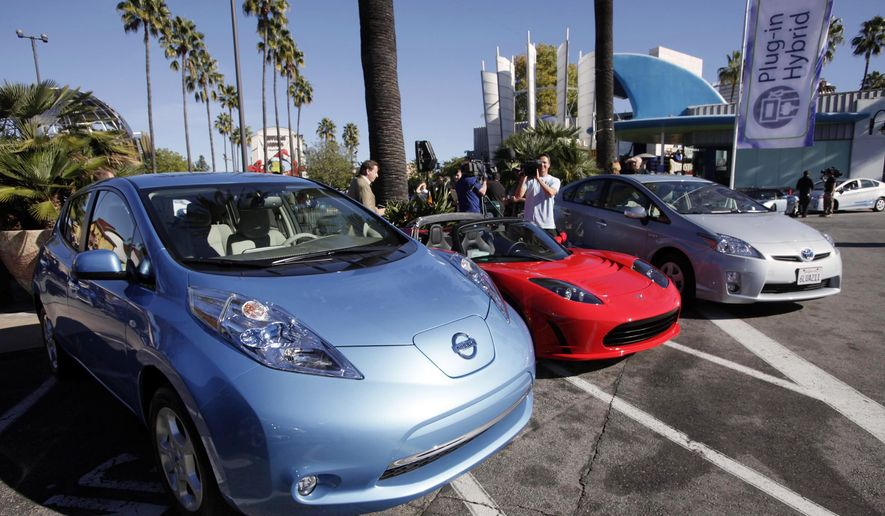 FILE - This Dec. 13, 2013 file photo shows from left, electric cars from Nissan,Tesla, and Toyota presented at a news conference in Los Angeles. Mayor Eric Garcetti unveiled a plan on Wednesday, April 8, 2015, designed to make Los Angeles a more green and liveable city. The plan envisions more solar panels on rooftops and an expanded public transportation system. (AP Photo/Nick Ut,File)