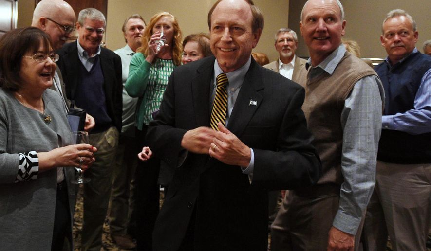 Colorado Springs mayoral candidate John Suthers takes the stage at his watch party at the Wyndham Mining Exchange Hotel, Tuesday, April 7, 2015, in Colorado Springs, Colo. Six candidates are vying to replace incumbent Steve Bach in a mail election that ends Tuesday. (AP Photo/The Gazette, Jerilee Bennett) MAGS OUT