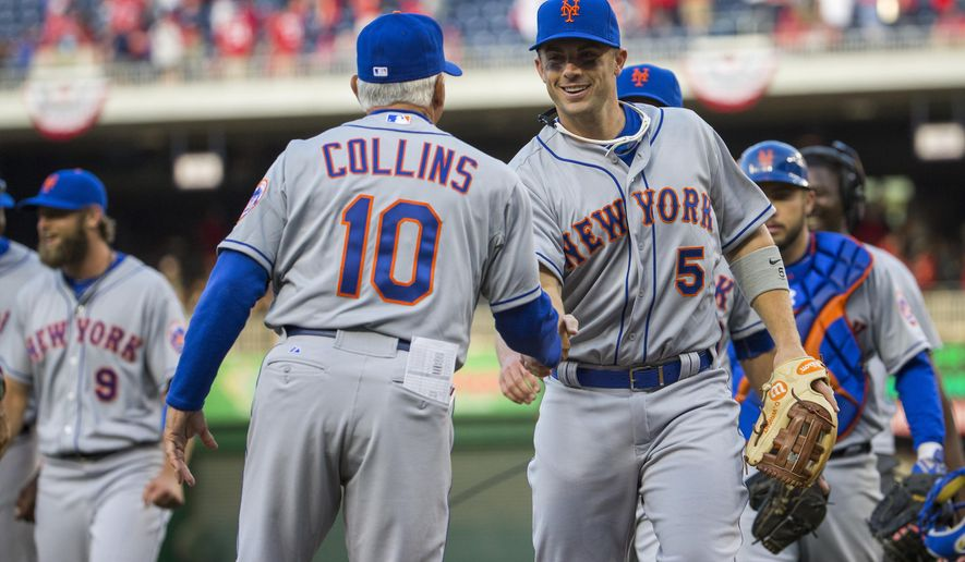 New York Mets third baseman David Wright (5) shakes hands with manager Terry Collins after an opening day baseball game victory over the Washington Nationals at Nationals Park on Monday, April 6, 2015, in Washington. The Mets defeated the Nationals 3-1. (AP Photo/Evan Vucci)