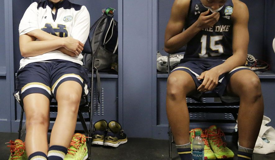 Notre Dame forward Kathryn Westbeld, left and Notre Dame guard Lindsay Allen (15) sit in the locker room after the second half of the NCAA women's Final Four tournament college basketball championship game, Tuesday, April 7, 2015, in Tampa, Fla. Connecticut won 63-53. (AP Photo/Brynn Anderson )