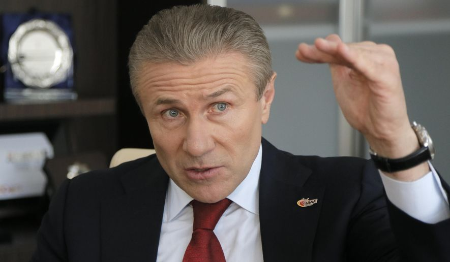 Sergei Bubka talks with reporters during an interview with the Associated Press in Kiev, Ukraine, Wednesday, April 8, 2015. Pole vault great Sergei Bubka releases his manifesto as part of his campaign for IAAF president. (AP Photo/Efrem Lukatsky)