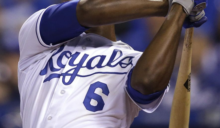 Kansas City Royals' Lorenzo Cain watches his two-run home run during the eighth inning of a baseball game against the Chicago White Sox at Kauffman Stadium in Kansas City, Mo., Wednesday, April 8, 2015. The Royals defeated the White Sox 7-5. (AP Photo/Orlin Wagner)