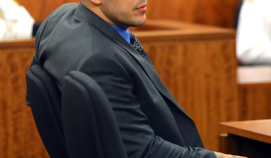Former New England Patriots football player Aaron Hernandez  looks over the jury during closing arguments in his trial in Fall River, Mass., Tuesday, April 7, 2015.  Hernandez is accused of killing Odin Lloyd in June 2013.  (AP Photo/The Boston Globe, John Tlumacki, Pool)