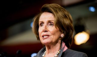 House Minority Leader Nancy Pelosi of California speaks during a news conference on Capitol Hill in Washington in this March 26, 2015, file photo. (AP Photo/Andrew Harnik, File)