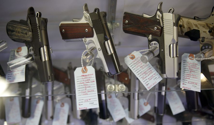 Firearms industry backers say they aren't surprised firearms buyers and manufacturers alike have responded to the national gun control debate by making and purchasing more. (Associated Press)
