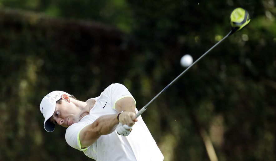 Rory McIlroy, of Northern Ireland, tees off on the second hole during a practice round for the Masters golf tournament Wednesday, April 8, 2015, in Augusta, Ga. (AP Photo/Matt Slocum)