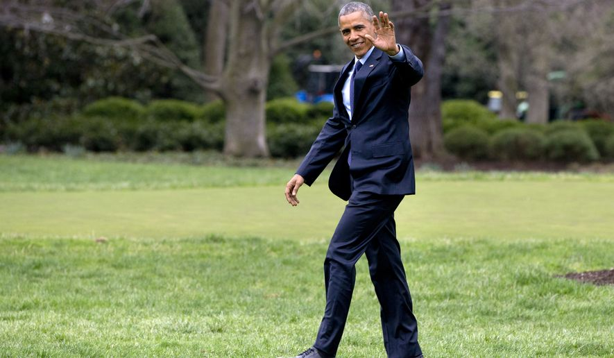 President Barack Obama waves as he walks across the South Lawn to board the Marine One helicopter en route to a trip to Jamaica and Panama, Wednesday, April 8, 2015, in Washington. (AP Photo/Jacquelyn Martin)