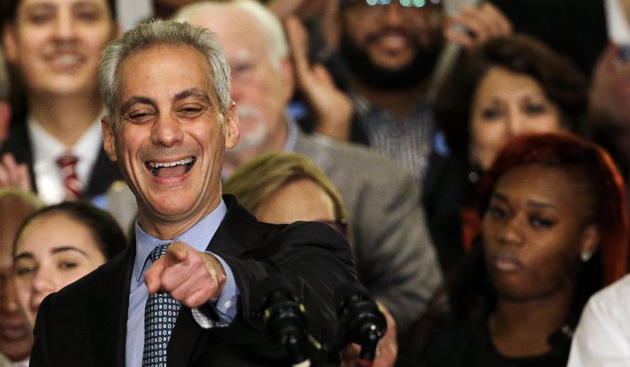 Chicago Mayor Rahm Emanuel smiles as he pints to a sign during a victorious election night at Plumbers Local 130 Union Hall, Tuesday, April 7, 2015, in Chicago. Emanuel won re-election Tuesday as voters in Chicago's first mayoral runoff decided that, despite his brusque management style, the former White House chief of staff was best equipped to deal with the dire financial challenges facing the nation's third-largest city. (AP Photo/Nam Y. Huh)