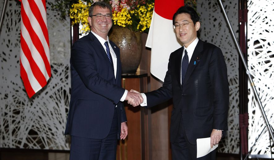 U.S. Defense Secretary Ash Carter, left, shakes hands with Japanese Foreign Minister Fumio Kishida before their working lunch at the foreign ministry's Iikura guest house in Tokyo Wednesday, April 8, 2015. (AP Photo/Yuya Shino, Pool)