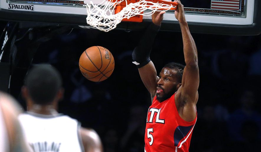 Atlanta Hawks' DeMarre Carroll dunks to finish off a fast break against the Brooklyn Nets during the first quarter of an NBA basketball game Wednesday, April 8, 2015, in New York. (AP Photo/Jason DeCrow)