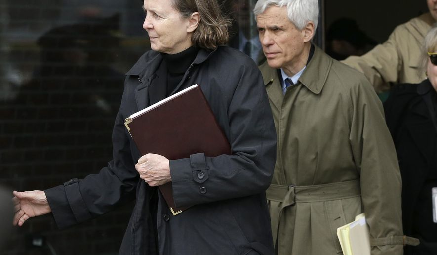 Defense attorneys Judy Clarke, left, and David Bruck leave federal court Wednesday, April 8, 2015, in Boston where their client Dzhokhar Tsarnaev was convicted on multiple charges in the 2013 Boston Marathon bombing. Three people were killed and more than 260 were injured when twin pressure-cooker bombs exploded near the finish line.  (AP Photo/Steven Senne)