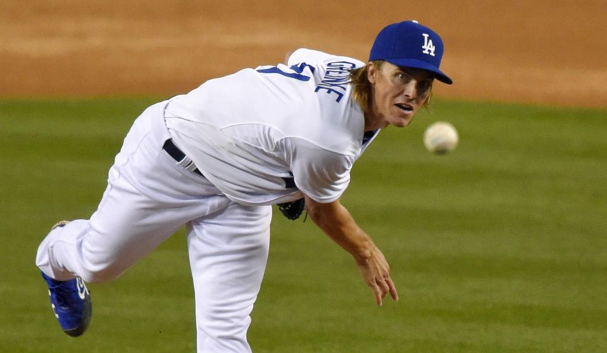 Los Angeles Dodgers starting pitcher Zack Greinke throws to the plate during the first inning of a baseball game against the San Diego Padres, Tuesday, April 7, 2015, in Los Angeles. (AP Photo/Mark J. Terrill)