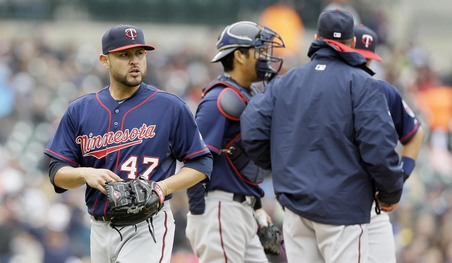 Minnesota Twins starting pitcher Ricky Nolasco is relieved during the fourth inning of a baseball game against the Detroit Tigers, Wednesday, April 8, 2015, in Detroit. (AP Photo/Carlos Osorio)