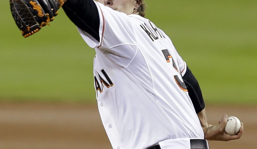 Miami Marlins starting pitcher Tom Koehler (34) prepares to pitch against the Atlanta Braves in the first inning of a baseball game, Wednesday, April 8, 2015, in Miami. (AP Photo/Alan Diaz)