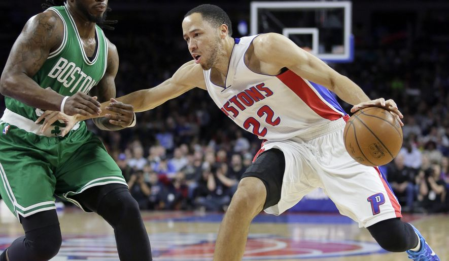 Detroit Pistons' Tayshaun Prince (22) tries to go to the basket against Boston Celtics' Jae Crowder during the first half of an NBA basketball game Wednesday, April 8, 2015, in Auburn Hills, Mich. (AP Photo/Duane Burleson)