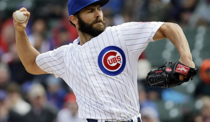 Chicago Cubs starter Jake Arrieta throws against the St. Louis Cardinals during the first inning of a baseball game in Chicago, Wednesday, April  8, 2015. (AP Photo/Nam Y. Huh)