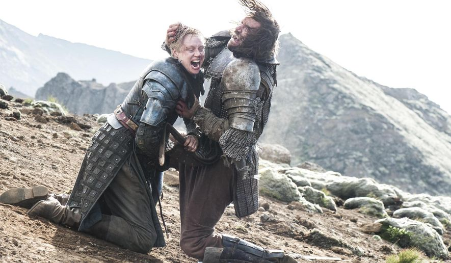 "In this image released by HBO, Brienne of Tarth, portrayed by Gwendoline Christie, left, battles with  Sandor ""The Hound"" Clegane, portrayed by Rory McCann, in a scene from season four of ""Game of Thrones."" The season five premiere airs on Sunday. (AP Photo/HBO, Helen Sloan)"