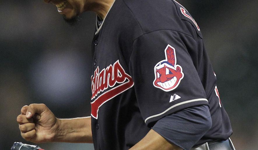Cleveland Indians pitcher Carlos Carrasco reacts after striking out Houston Astros Evan Gattis during the sixth inning of a baseball game, Wednesday, April 8, 2015, in Houston. (AP Photo/Patric Schneider)