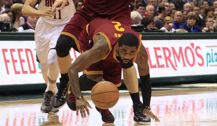 Cleveland Cavaliers guard Kyrie Irving tries to regain control of the ball against the Milwaukee Bucks during the first half of an NBA basketball game Wednesday, April 8, 2015 in Milwaukee. (AP Photo/Darren Hauck)