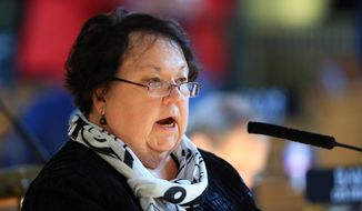 Then-Nebraska state Sen. Kathy Campbell of Lincoln speaks in favor of Medicaid expansion during debate in the Legislative Chamber in Lincoln, Neb., Wednesday, April 8, 2015. (AP Photo/Nati Harnik) ** FILE **