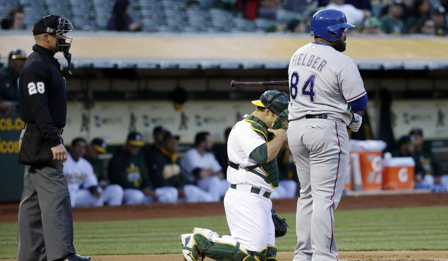 Texas Rangers' Prince Fielder, right, steps off the plate between pitches during the first inning of a baseball game against the Oakland Athletics Wednesday, April 8, 2015, in Oakland, Calif. (AP Photo/Marcio Jose Sanchez)