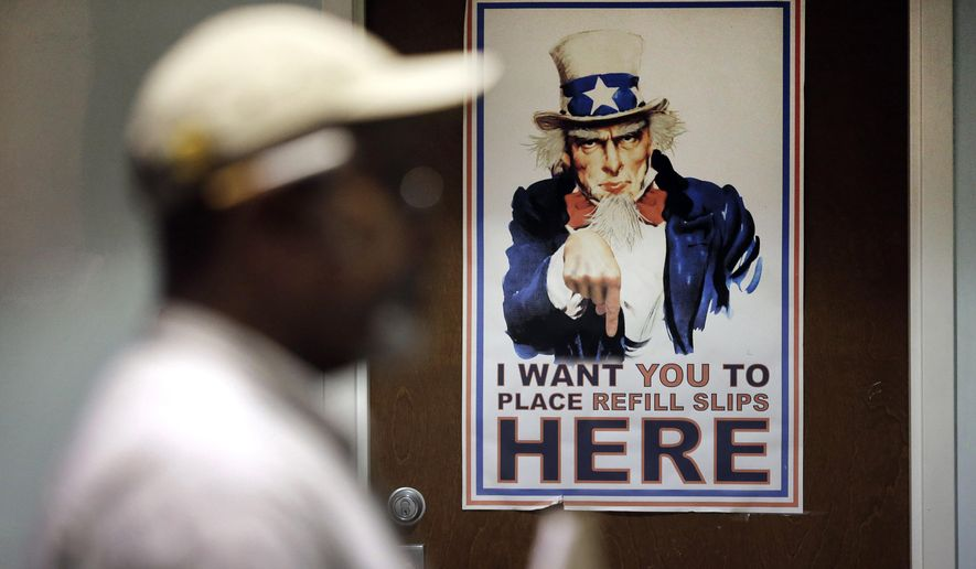 In this March 11, 2015 photo, a poster depicting Uncle Sam greets clients in a pharmacy waiting room at the Fayetteville Veterans Affairs Medical Center in Fayetteville, N.C. According to government data reviewed by The Associated Press in March 2015, the number of patients facing long waits for treatment at VA clinics and hospitals has not dropped, even after the agency got a $16.3 billion budget boost and instituted major reforms. (AP Photo/Patrick Semansky)