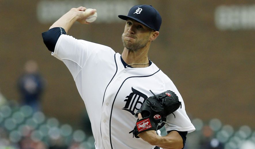 Detroit Tigers starting pitcher Shane Greene throws during the first inning of a baseball game against the Minnesota Twins, Thursday, April 9, 2015, in Detroit. (AP Photo/Carlos Osorio)