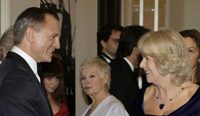 "In this Tuesday, Oct. 23, 2012, file photo, Britain's Duchess of Cornwall, right, talks with James Bond actor Daniel Craig, left, and Dame Judi Dench, center, as she arrives to attend the world premiere of the James Bond film, ""Skyfall"", at the Royal Albert Hall, in London. (AP Photo/Kirsty Wigglesworth, File)"