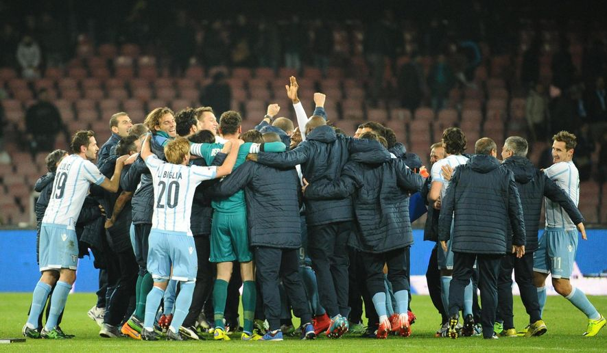 Lazio players celebrate at the end of an Italian Cup semifinal soccer match between Napoli and Lazio at the San Paolo stadium in Naples, Italy, Wednesday, April 8, 2015. A late goal from Senad Lulic gave Lazio a 1-0 victory over Napoli on Wednesday and a place in the Italian Cup final against Juventus. (AP Photo/Ciro Fusco, Ansa)