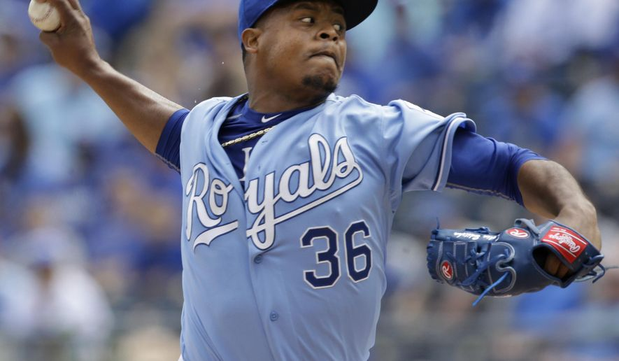 Kansas City Royals starting pitcher Edinson Volquez (36) delivers to a Chicago White Sox batter during the first inning of a baseball game at Kauffman Stadium in Kansas City, Mo., Thursday, April 9, 2015. (AP Photo/Orlin Wagner)