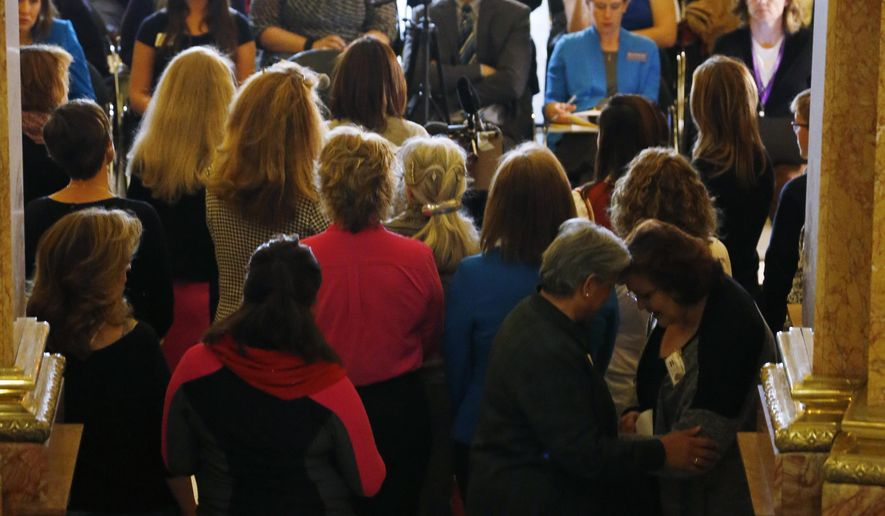 A group opposed to standardized testing for students holds a news conference in the west foyer of the State Capitol in Denver Thursday, April 9, 2015. The group was on hand to speak about two bills, one that would require the repeal and rewriting of certain state testing standards as well as measure to revamp the state's school testing regime, that were to be heard by members of a state education committee Thursday. (AP Photo/David Zalubowski)
