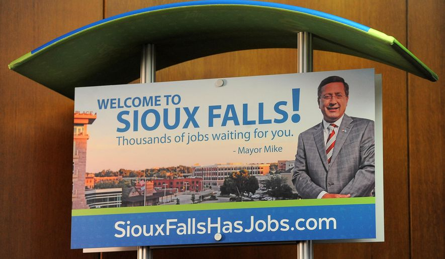Mock ups of signage promoting www.SiouxFallsHasJobs.com during a news conference at City Hall in Sioux Falls, S.D. on Thursday, April 2, 2015. (AP Photo/Argus Leader, Jay Pickthorn)