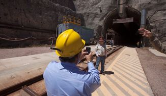 Rep. Michael Burgess, Texas Republican, tours Yucca Mountain in Nevada after newly published Nuclear Regulatory Commission staff findings appear to provide wiggle room for adopting rules to open a national nuclear waste dump in the Nevada desert, if decision-makers want to go forward. (ASSOCIATED PRESS PHOTOGRAPHS)