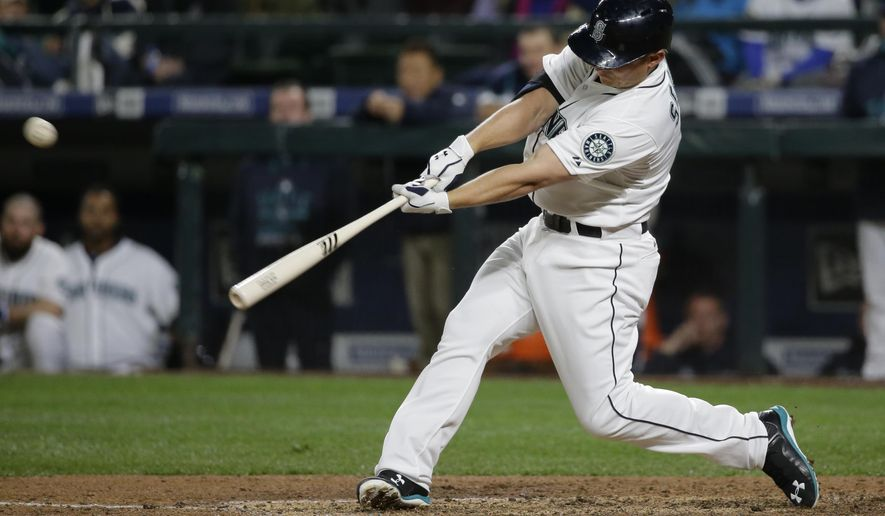 Seattle Mariners' Kyle Seager hits a two-run home run against the Los Angeles Angels during the sixth inning of a baseball game, Wednesday, April 8, 2015, in Seattle. (AP Photo/Ted S. Warren)