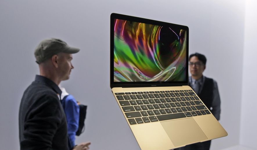 In this March 9, 2015, file photo, members of the media and Apple guests get a look at the new MacBook in the demo room after an Apple event in San Francisco. A survey by Verto Analytics released on June 21, 2017, found that only 2 percent of Mac users were thinking of switching to a Windows-based PC in the next two years, compared to 21 percent of Windows laptop and 25 percent of Windows desktop users planning a switch to Mac. (AP Photo/Eric Risberg, File) ** FILE **