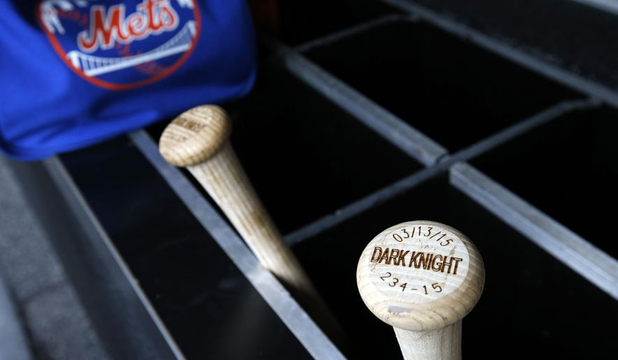 "The bats of New York Mets starting pitcher Matt Harvey are labeled ""dark knight,"" in the dugout before a baseball game against the Washington Nationals at Nationals Park, Thursday, April 9, 2015, in Washington. Harvey will pitch in a major league game for the first time since August 2013, returning from Tommy John surgery. (AP Photo/Alex Brandon)"